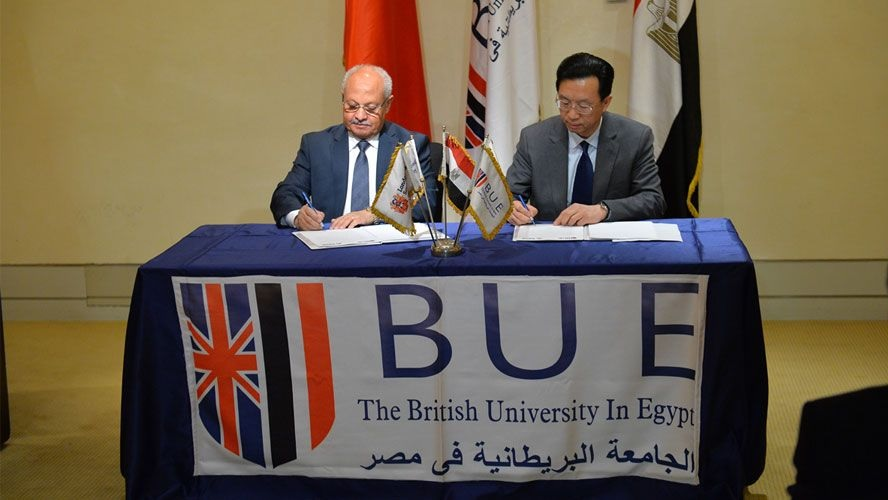 Herbert Chen of TusPark (right) signs the collaboration agreement with the British University in Egypt