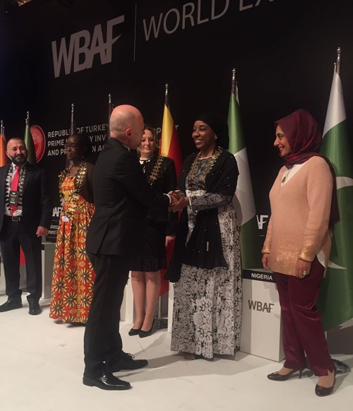 Hauwa Yabani receives her High Commissioner's medallion