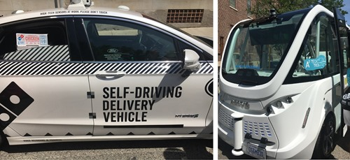 Two of the Tech Trek's self driving vehicles, including pizza delivery!